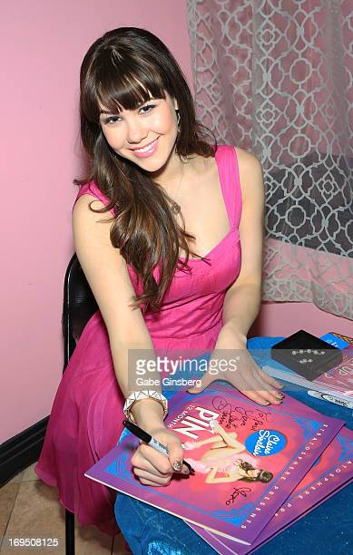 Model Claire Sinclair signs autographs at the Bettie Page Clothing store inside the Miracle Mile Shops at Planet Hollywood Resort Casino on May 25...