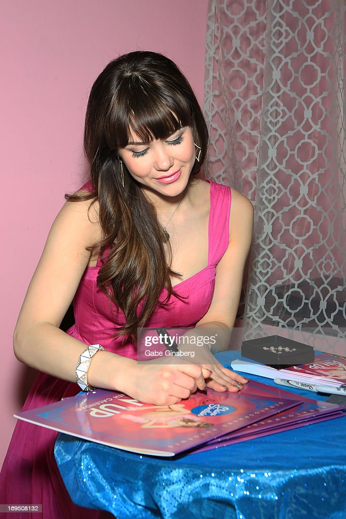 Model Claire Sinclair signs autographs at the Bettie Page Clothing store inside the Miracle Mile Shops at Planet Hollywood Resort & Casino on May 25, 2013 in Las Vegas, Nevada.