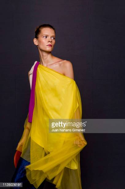 A model Claudia Gago is seen backstage before the Ulises Merida fashion show during Mercedes Benz Fashion Week Madrid Autumn/Winter 201920 on January...