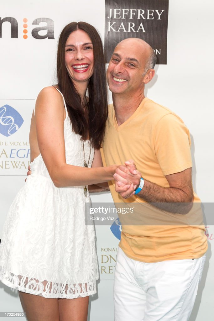 Model Claudia Graf (L) and actor David Marciano arrive at 'The Fountain Of Youth White Party' to Celebrate
