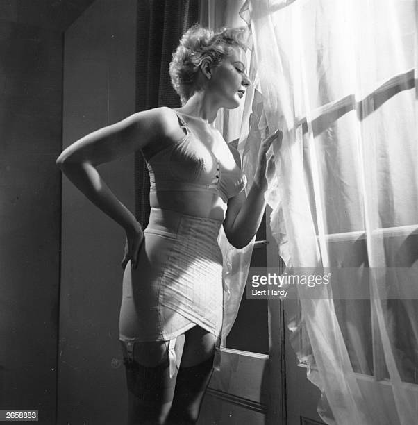 Model Claudia Kerr wears a corset from America Completely boneless and made of light embroidered nylon and elastic net it was cut 'sarong style' and...