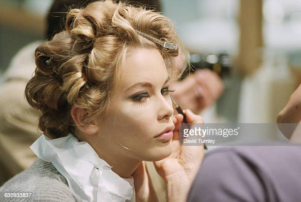 Model Claudia Schiffer gets her hair and makeup done for a fashion show at the Musee du Louvre in Paris France