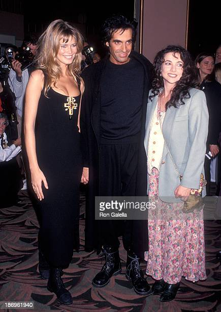 Model Claudia Schiffer magician David Copperfield and actress Emma Samms attend David Copperfield's Magic Show to Benefit the Starlight Children's...