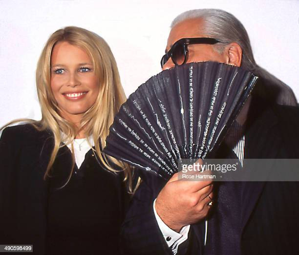 Model Claudia Schiffer stands next to designer Karl Lagerfeld attend the latter's exhibit 'Visages et Paysages' at a Soho gallery New York New York...