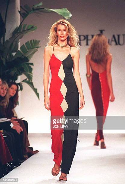 Model Claudia Schiffer wears a full length spaghetti strap red and navy dress in the showing of the Ralph Lauren Spring 1996 fashion collection 30...