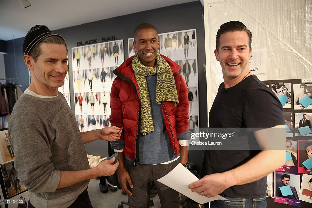Model Claudio Montiero (c) and Vice President Design & Creative of Nautica Chris Cox (right) attend a fitting prior to a show for Black Sail by Nautica at Natuica Studio on January 31, 2014 in New York City.