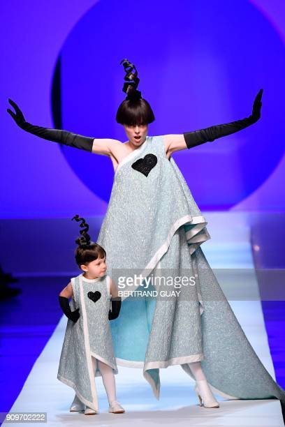 Model Coco Rocha and her daughter Ioni Conran present creations by Jean-Paul Gaultier during the 2018 spring/summer Haute Couture collection fashion...
