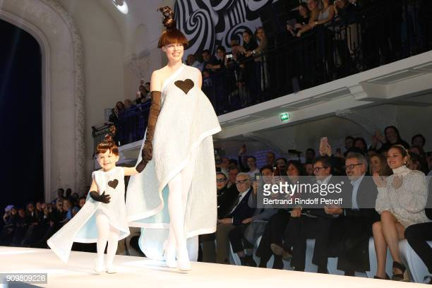 Model Coco Rocha and her daughter Ioni Conran walk the runway in front of Pierre Cardin Mademoiselle Agnes Boulard Emmanuelle Alt Owners of Gaultier...