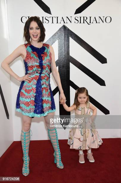 Model Coco Rocha and her daughter Ioni James Conran attend the Christian Siriano fashion show during New York Fashion Week at Grand Lodge on February...