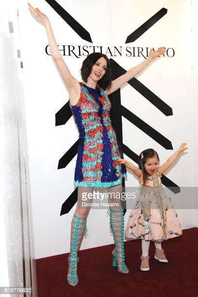 Model Coco Rocha and her daughter Ioni James Conran pose backstage for the Christian Siriano fashion show during New York Fashion Week at the Grand...