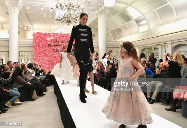 Model Coco Rocha and her daughter Ioni James Conran walk the runway in support of Runway Heroes to Benefit Childhood Cancer Research at Kleinfeld on...