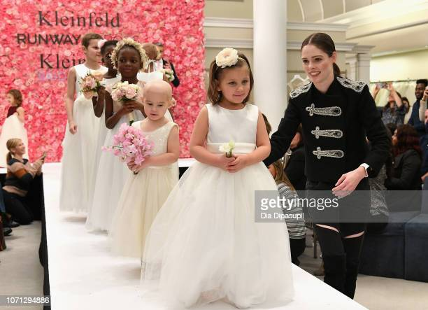 Model Coco Rocha cheers on 30 childhood cancer fighters and survivors as they walk the runway during Runway Heroes to Benefit Childhood Cancer...