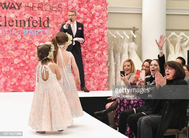 Model Coco Rocha cheers on childhood cancer fighter and survivor and her daughter Ioni James Conran as they walk the runway during Runway Heroes to...