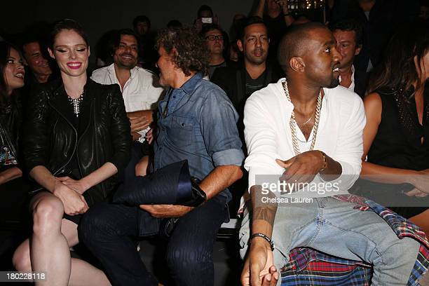 Model Coco Rocha fashion designer Renzo Rosso and musician Kanye West attend the Diesel Black Gold fashion show during MercedesBenz Fashion Week...