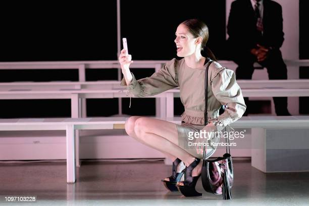 Model Coco Rocha films her daughter Ioni James Conran on a mobile phone before the Rebecca Minkoff front row during New York Fashion Week The Shows...