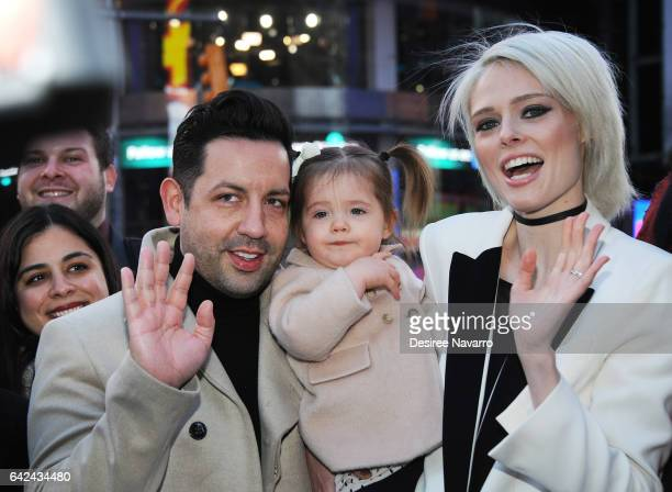 Model Coco Rocha husband James Conran and daughter Ioni James Conran ring The Nasdaq Closing Bell at NASDAQ on February 17 2017 in New York City
