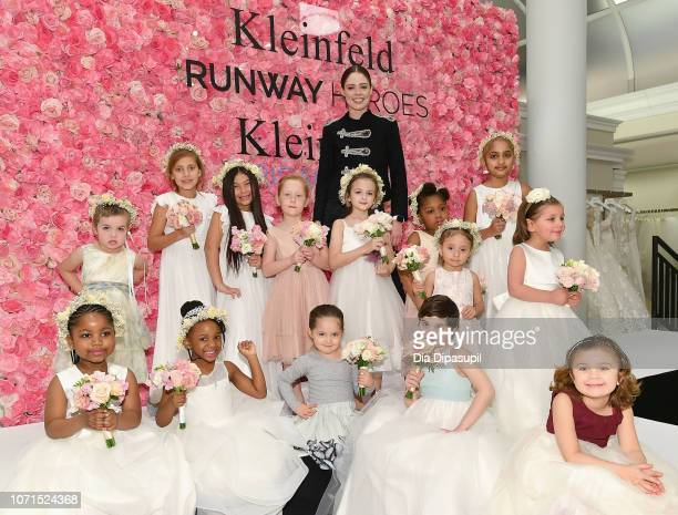 Model Coco Rocha Ioni James Conran and cancer fighters and survivors pose onstage during Runway Heroes to Benefit Childhood Cancer Research at...