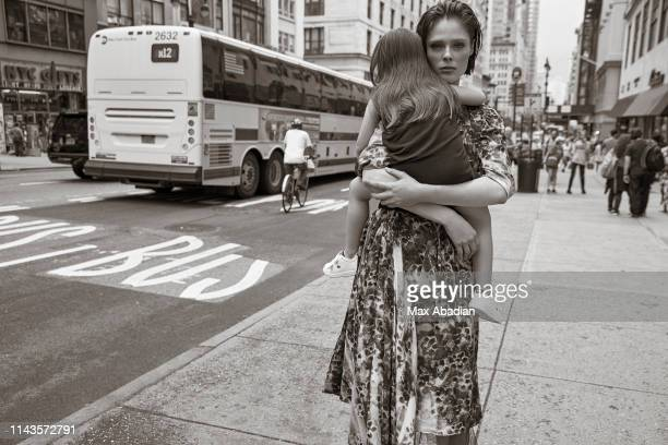 Model Coco Rocha poses with daughter Ioni at a fashion shoot for Madame Figaro on July 6, 2018 in New York City. PUBLISHED IMAGE.
