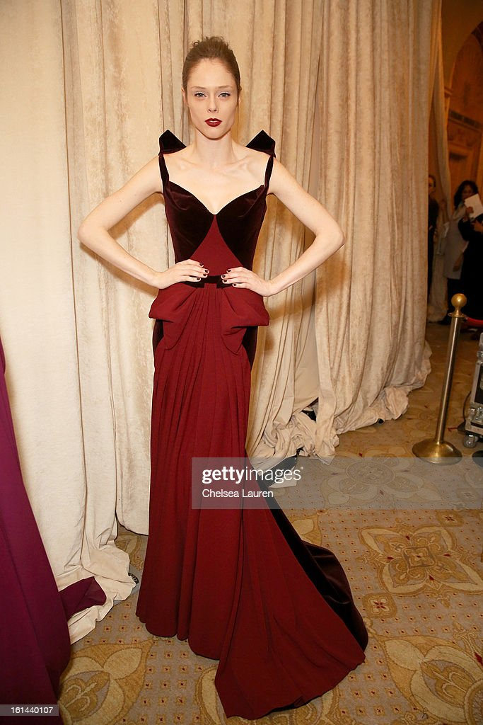 Model Coco Rocha prepares backstage at the Zac Posen Fall 2013 fashion show during Mercedes-Benz Fashion Week on February 10, 2013 in New York City.