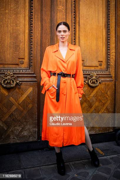 Model Coco Rocha, wearing an orange long dress, black belt and black boots, is seen outside Jean Paul Gaultier show during Paris Fashion Week - Haute...