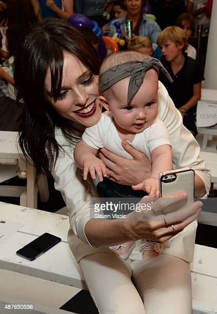 Model Coco Rocha with daughter Ioni James Conran attend Paul Frank Industries' debut of children's Spring/Summer 2016 collection at New York Fashion...
