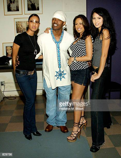 Model Coffey actor Jamie Foxx model Rebecca Justice and Lola Corwin attend the Exotic Spices Calendar photo session March 6 2002 in Los Angeles CA