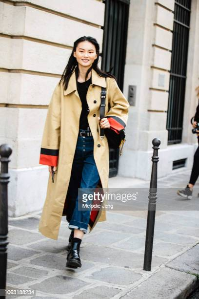 Model Cong He wears a tan coat after the Altuzarra show during Paris Fashion Week Spring/Summer 2019 on September 29 2018 in Paris France