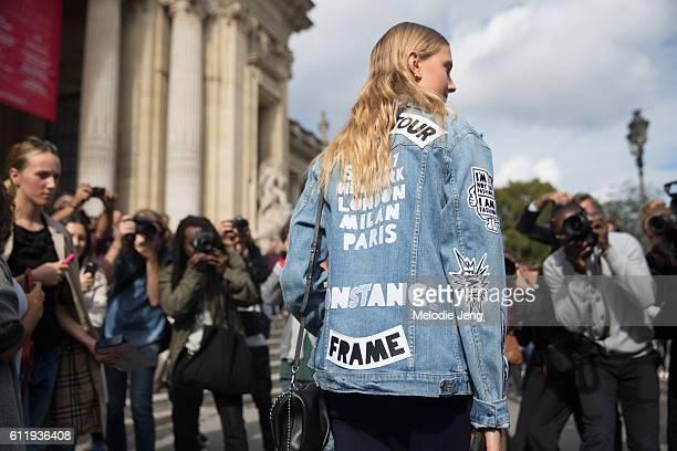 Model Constance Jablonski in a Frame Denim Fashion Week jacket outside the Mugler show at Grand Palais on October 1 2016 in Paris France
