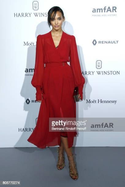 Model Cora Emmanuel attends the amfAR Paris Dinner 2017 at Le Petit Palais on July 2 2017 in Paris France