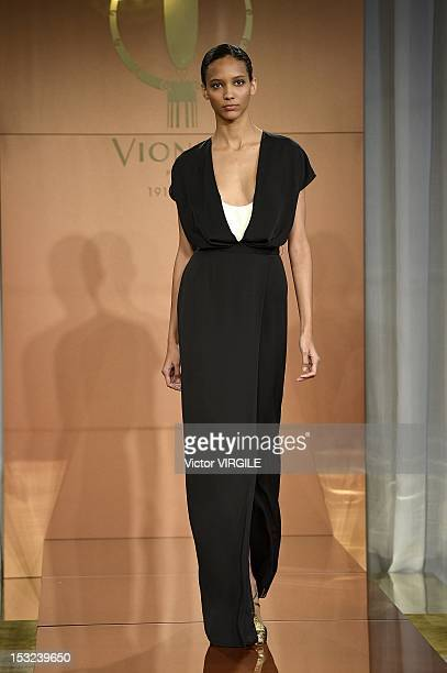 Model Cora Emmanuel walks the runway during the Vionnet Spring / Summer 2013 show as part of Paris Fashion Week at on September 27, 2012 in Paris,...