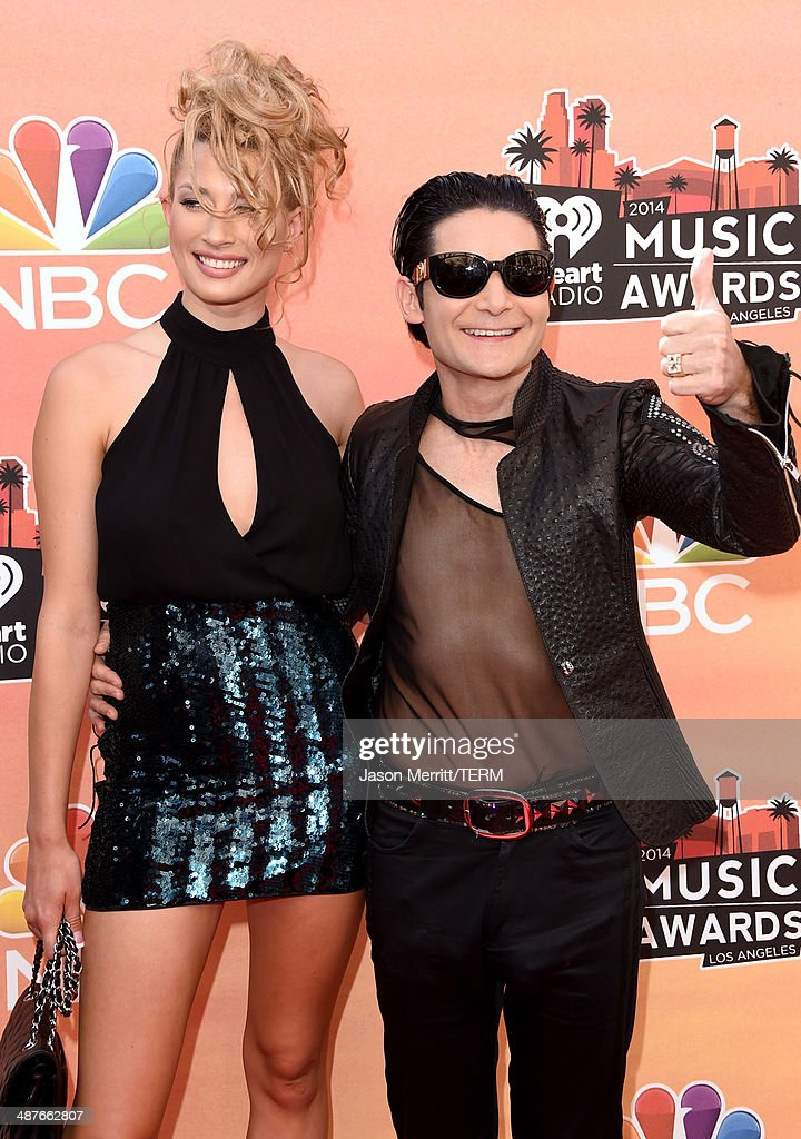 Model Courtney Anne(L) and actor Corey Feldman attend the 2014 iHeartRadio Music Awards held at The Shrine Auditorium on May 1, 2014 in Los Angeles, California. iHeartRadio Music Awards are being broadcast live on NBC.
