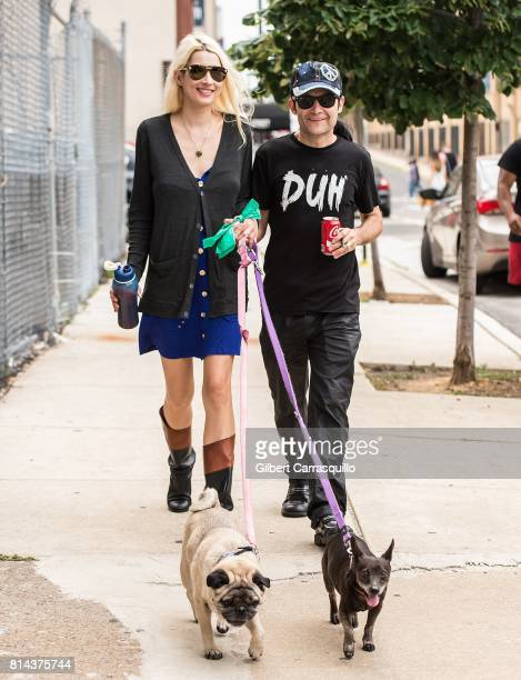 Model Courtney Anne Feldman and husband actor/singer Corey Feldman are seen walking their dogs Chewy and Brownie on July 13 2017 in Philadelphia...