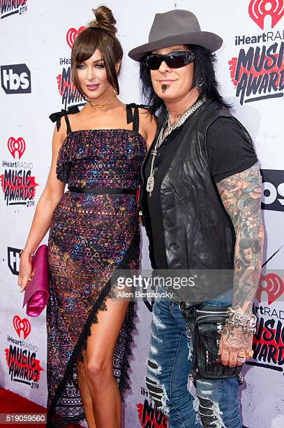 Model Courtney Sixx and musician Nikki Sixx arrive at the iHeartRadio Music Awards at The Forum on April 3 2016 in Inglewood California