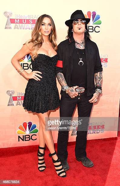 Model Courtney Sixx and recording artist/radio personality Nikki Sixx attend the 2015 iHeartRadio Music Awards which broadcasted live on NBC from The...