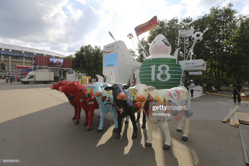 Model cow artworks stand on display beside the promotional pavilion for Chinese exports during preparations ahead of the FIFA World Cup outside the Luzhniki stadium in Moscow, Russia, on Wednesday, June 13, 2018. According to an April report from the organizing committee, the total amount spent on preparations is 683 billion rubles, or about $11 billion at the current exchange rate. Photographer: Andrey Rudakov/Bloomberg via Getty Images