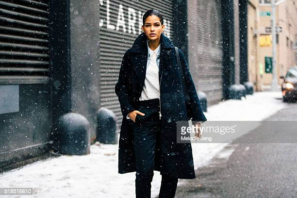 Model Cris Urena attends the 31 Phillip Lim show in the snow during New York Fashion Week Women's Fall/Winter 2016 on February 16 2016 in New York...