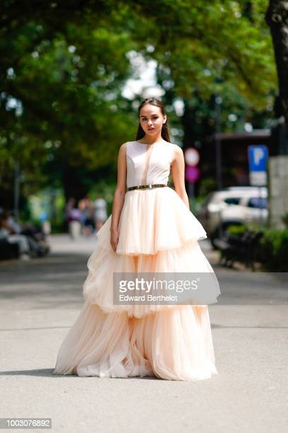 Model Cristina Comandari wears a beige and white lace mesh ruffled wedding dress from Cindyalan during Feeric Fashion Week 2018 on July 21 2018 in...