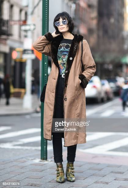 Model Cristina Piccone is seen wearing a brown coat vintage tshirt black jeans snake skin boots and silver sunglasses on the streets of Soho on...