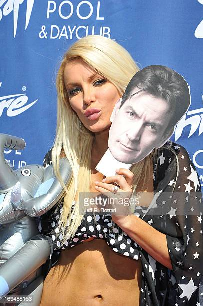 Model Crystal Hefner holds a cutout picture of Charlie Sheen's face as she appears at the Sapphire Pool Day Club's Memorial Day weekend celebration...