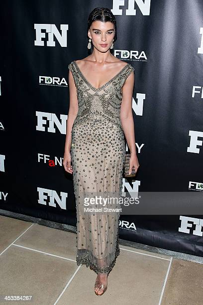 Model Crystal Renn attends the 27th Annual Footwear News Achievement Awards at the IAC Building on December 3, 2013 in New York City.