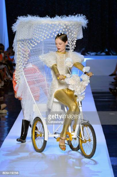 A model cycles on the runway at the Jean Paul Gaultier Autumn Winter 2017 fashion show during Paris Haute Couture Fashion Week on July 5 2017 in...
