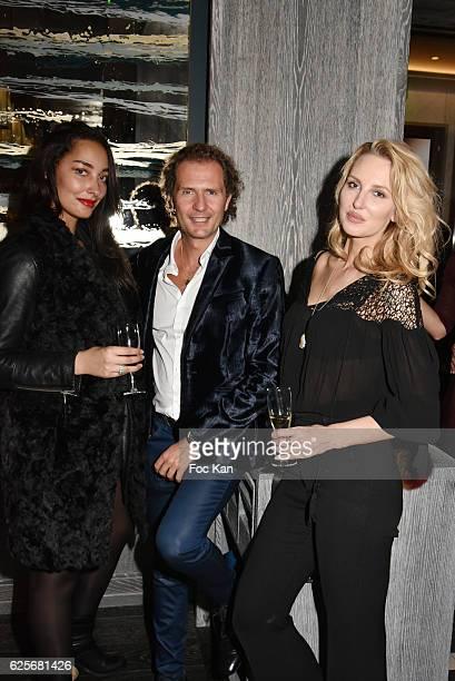 model Cynthia Lancien NIcolas Mereau and model Senta Schnabl attend 'Vibrations' Stefanie Renoma Photo Exhibition at Hotel Nolinski on November 24...