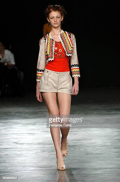 Model Cyntia Dicker walks the runway at the Sao Paulo Fashion Week Summer 2004/2005 Isabela Capeto Fashion Show at the Fundacao Bienal de Sao Paulo...