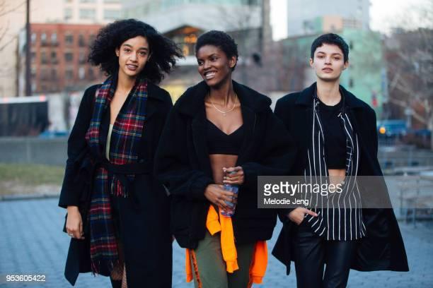 Model Damaris Goddrie, Amilna Estevao, Isabella Emmack after the Esteban Cortazar show at Spring Studios on February 14, 2018 in New York City.