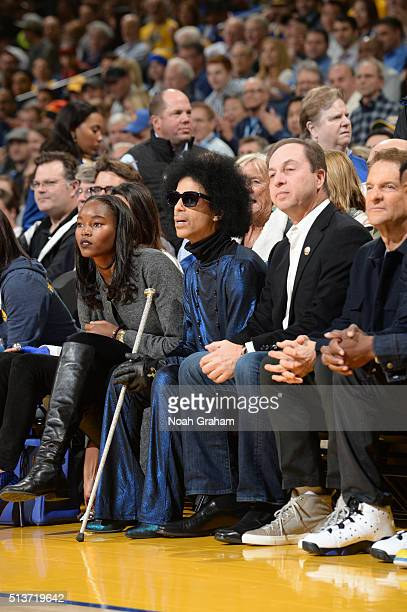 Model Damaris Lewis Singer Prince and CoOwner Joe Lacob of the Golden State Warriors takes in the game against the Oklahoma City Thunder on March 3...