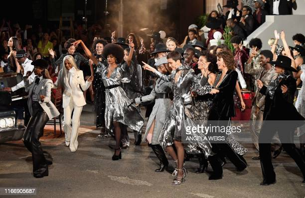 Model dance on the runway at the Tommy Hilfiger TommyNow fall runway show at the Apollo Theater on September 8 2019 in New York City