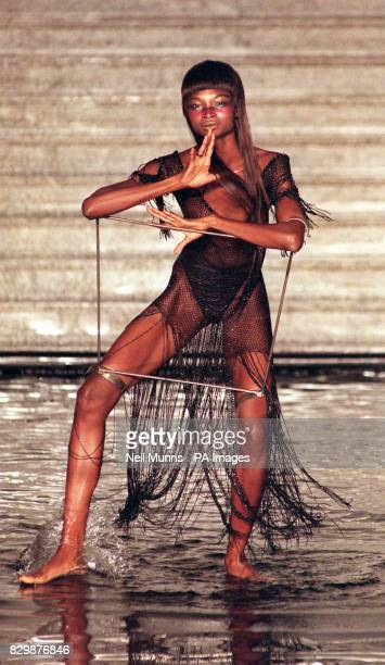 Model dances in water during the extravagant catwalk show for British designer Alexander McQueen in London's Royal Horticuture Halls this evening ....