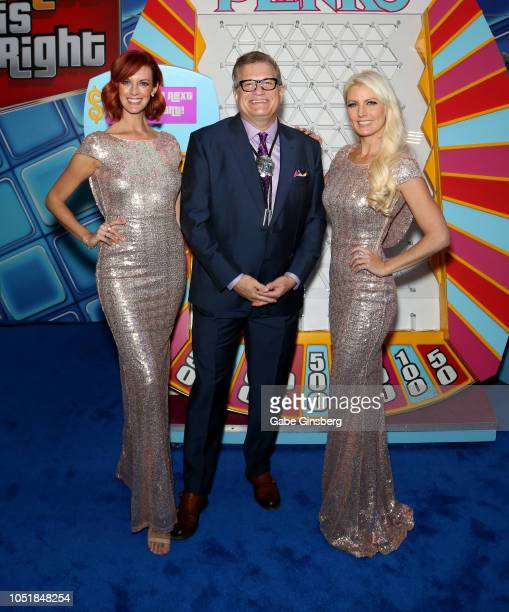 Model Dani Reeves actor/comedian Drew Carey and model Abigail Galloway pose in front of a Plinko game during IGT's announcement of The Price is Right...