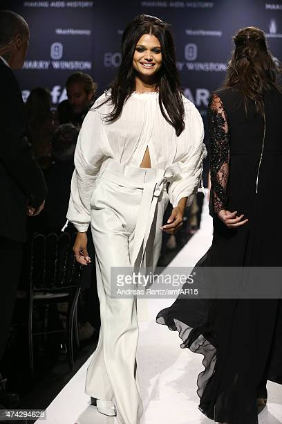 Model Daniela Braga walks during the fashion show runway during amfAR's 22nd Cinema Against AIDS Gala Presented By Bold Films And Harry Winston at...