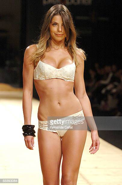 Model Daniela Cicarelli walks down the runway during the Lycra fashion presentation during the PreaPorter fashion exhibition August 10 2005 in Sao...
